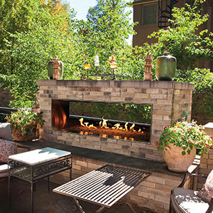 Upgrade Your Outdoor Living Space with this See Through Outdoor Brick Gas Fireplace