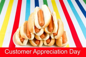 Plate of Hot Dogs on Colorful Striped Table Cloth