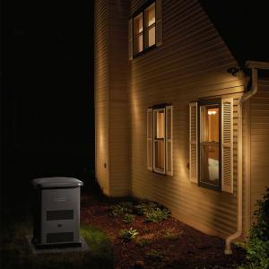 A standby generator outside a home helps to keep the lights on even during winter storm power outages.