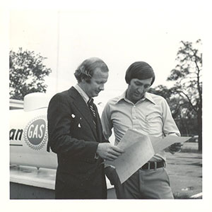 CEO John Blossman and Employee Reviewing Plans - Blossman Gas Founders History