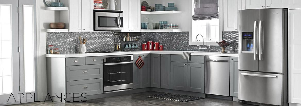 Gray and White Modern Kitchen with Stainless Steel Whirlpool Appliances propane gas appliances