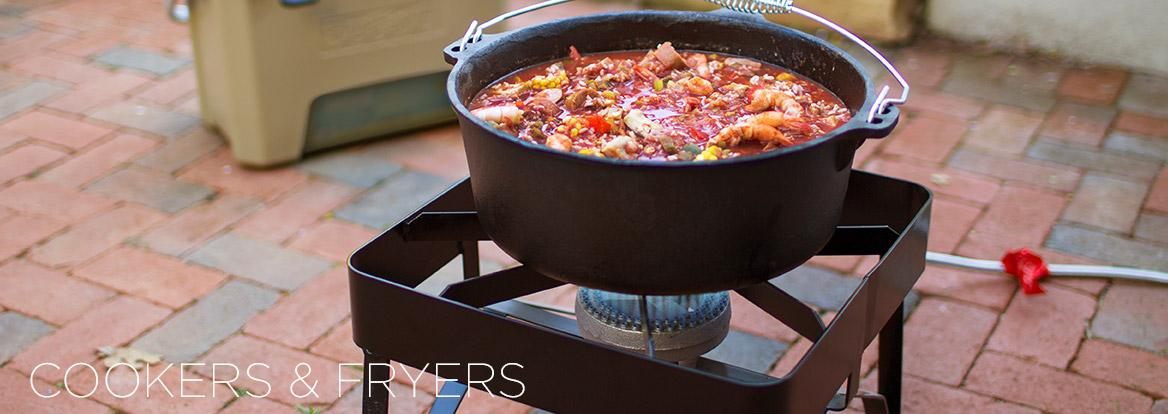 Coast iron pot of chili on outdoor gas cooker