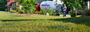 Gas Salesman walking through grass bobtail truck in background