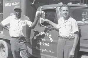 Black and White Historical Photo of Blossman Gas Employees Standing in Front of Truck