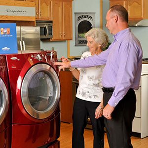 Manager Showing Customer Washer and Dryer