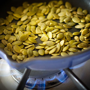 Toasted Pumpkin Seeds on Gas Cook Top