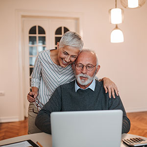Couple Paying Bills Online - Blossman Online Payments