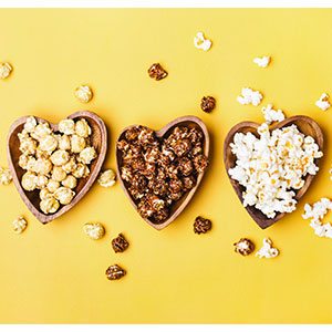 Flavored popcorn in heart shaped containers