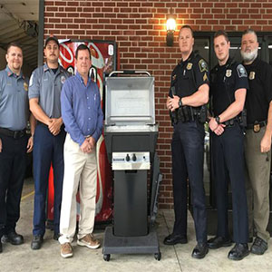 LaFayette Police and Fire Department Receiving Donated Grill From Blossman
