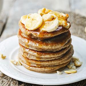 Banana Pecan Pancakes Stacked on Plate