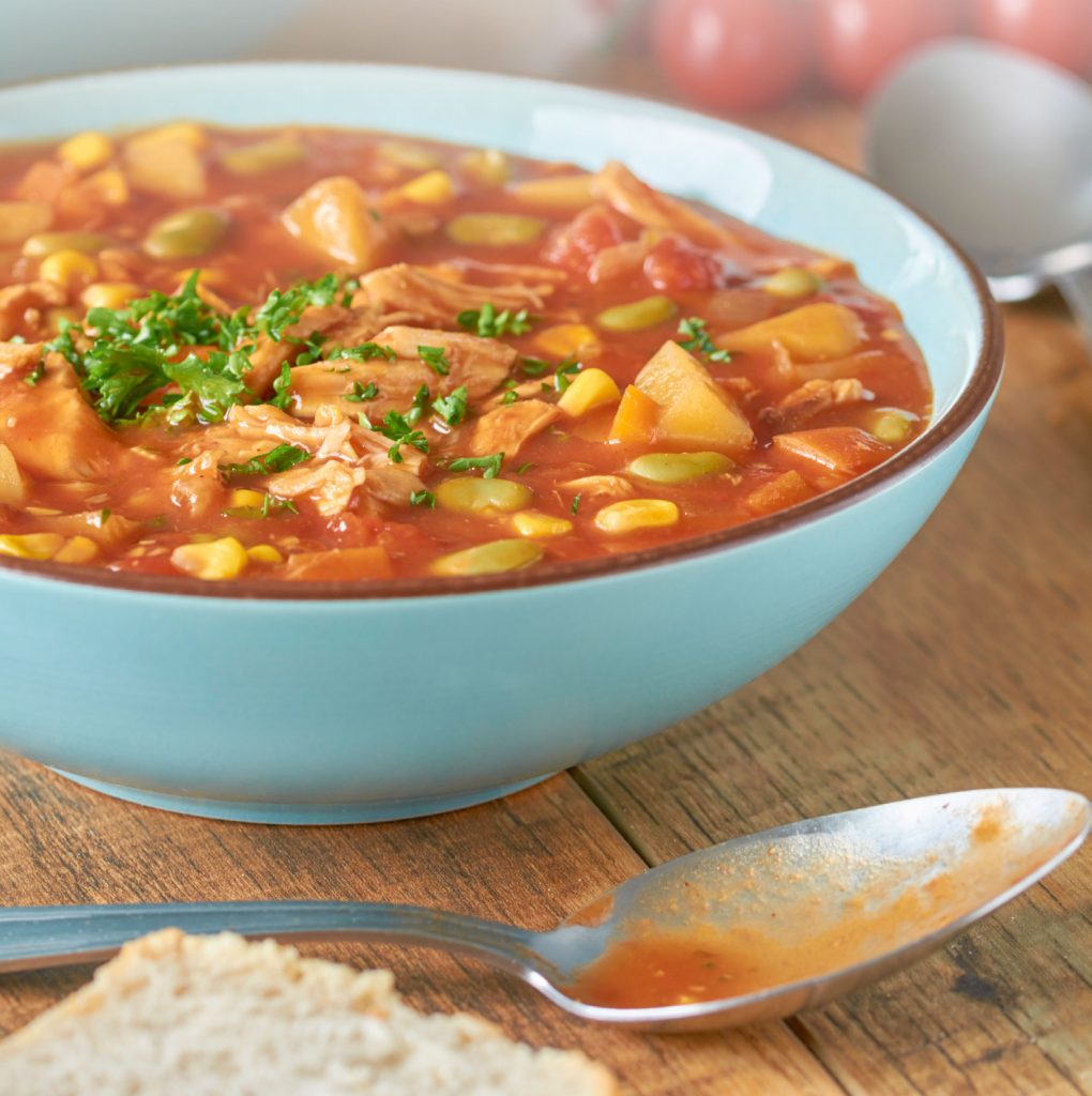 Brunswick Stew in Blue Blow with Spoon and Bread
