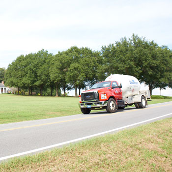 Blossman Bobtail Delivery Truck Driving on Road