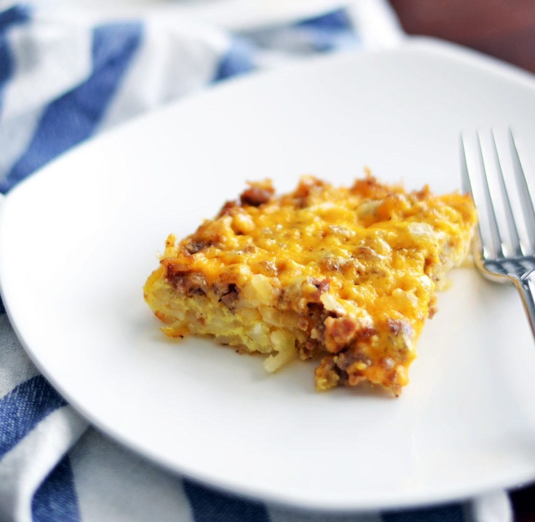 Breakfast Casserole on White Plate with Fork