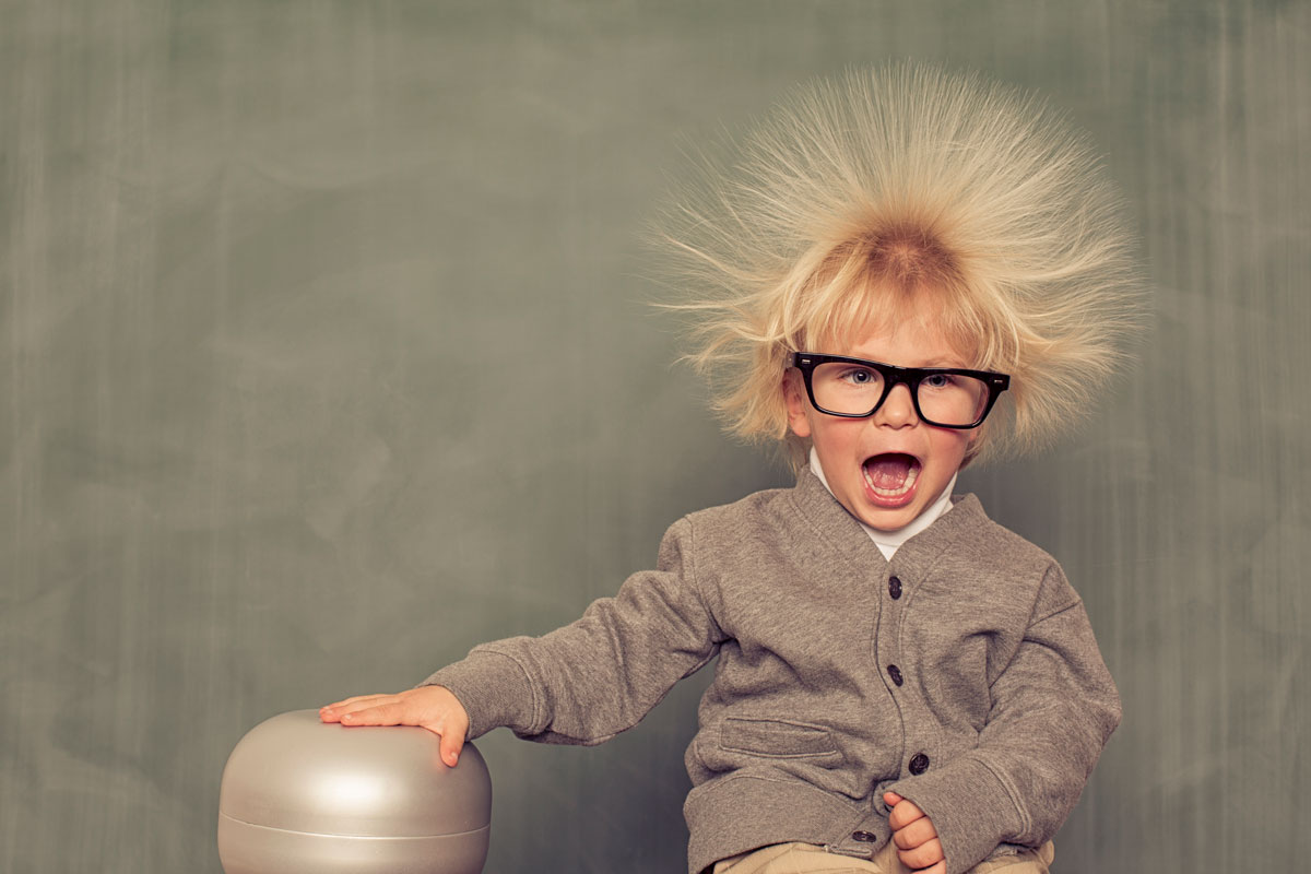 Child with glasses and static electric hair