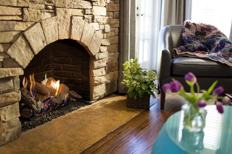 Gas logs brick fireplace