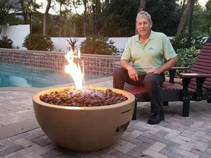 Fire Bowl by Pool with Owner